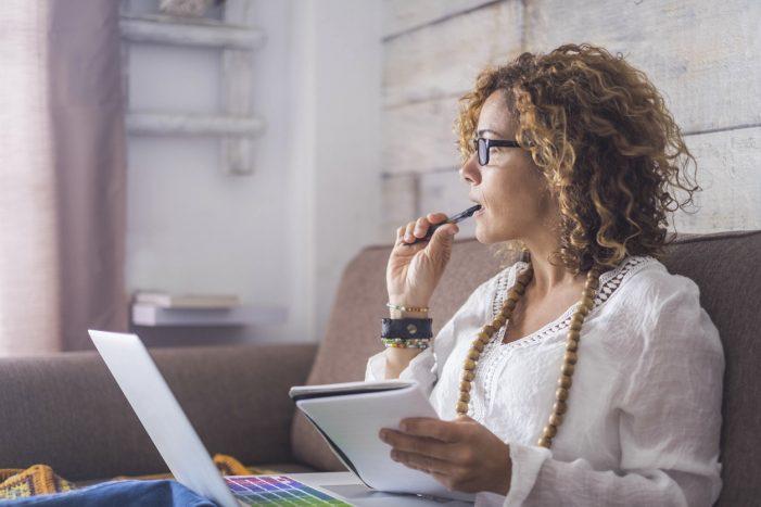 Woman on laptop thinking