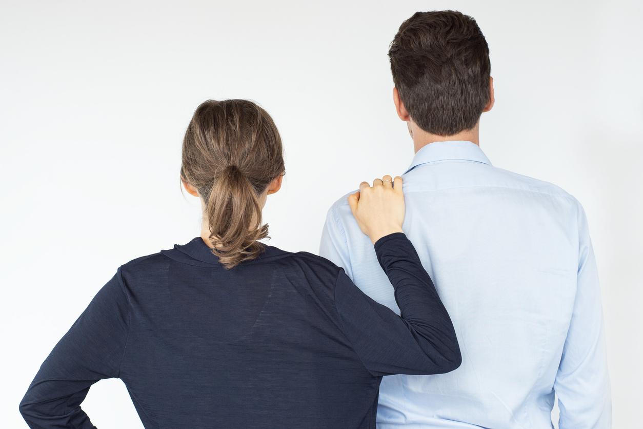 Wife leaning on husband's shoulder