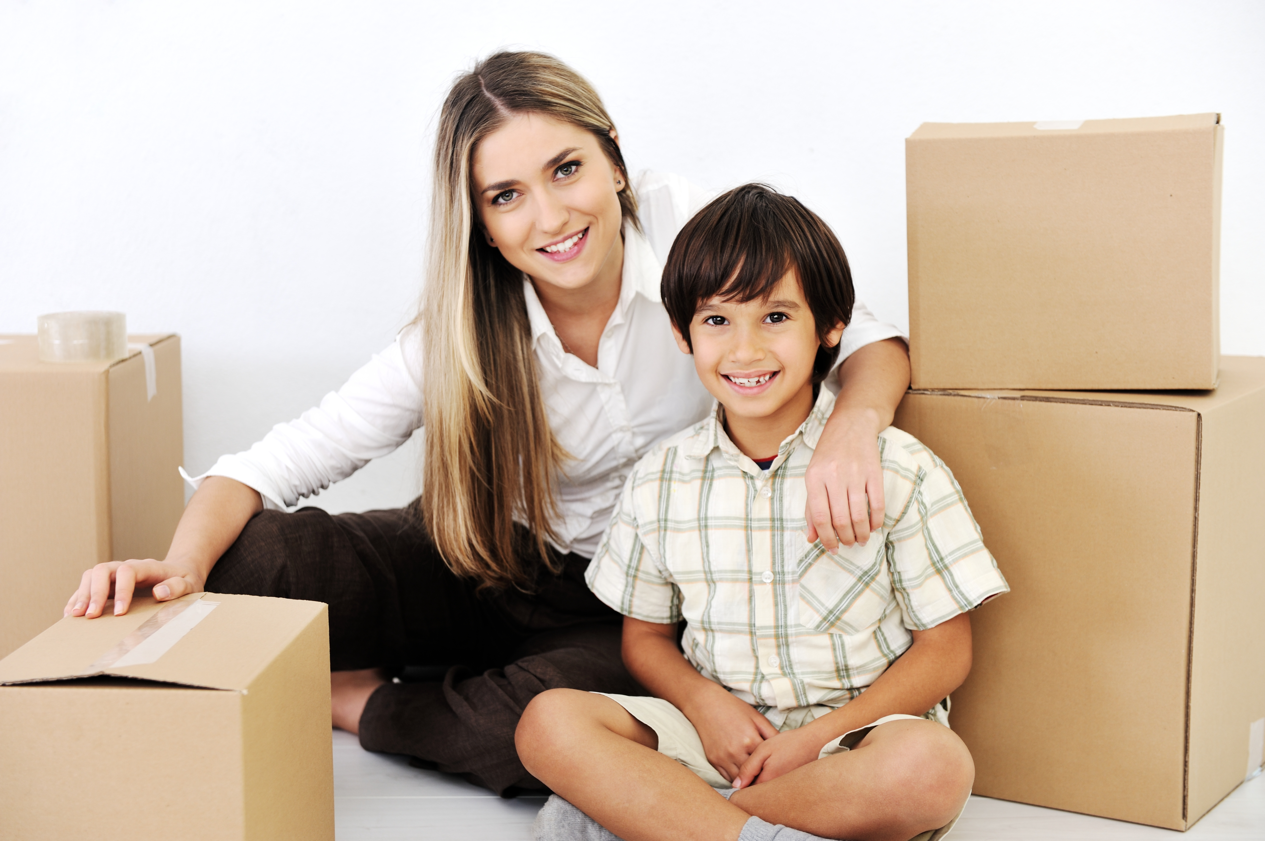 Mom and son with moving boxes