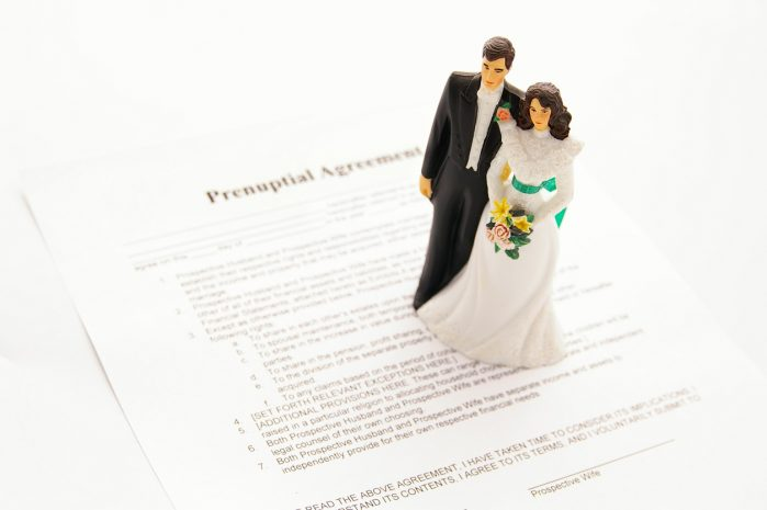 cake-topper wedding couple and a pre-nuptial agreement