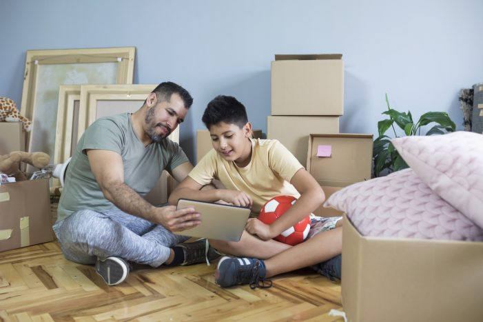 Dad and son moving