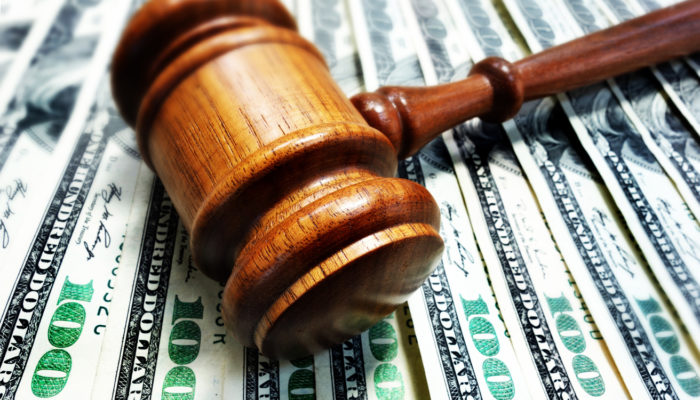 A court gavel on $100 bills