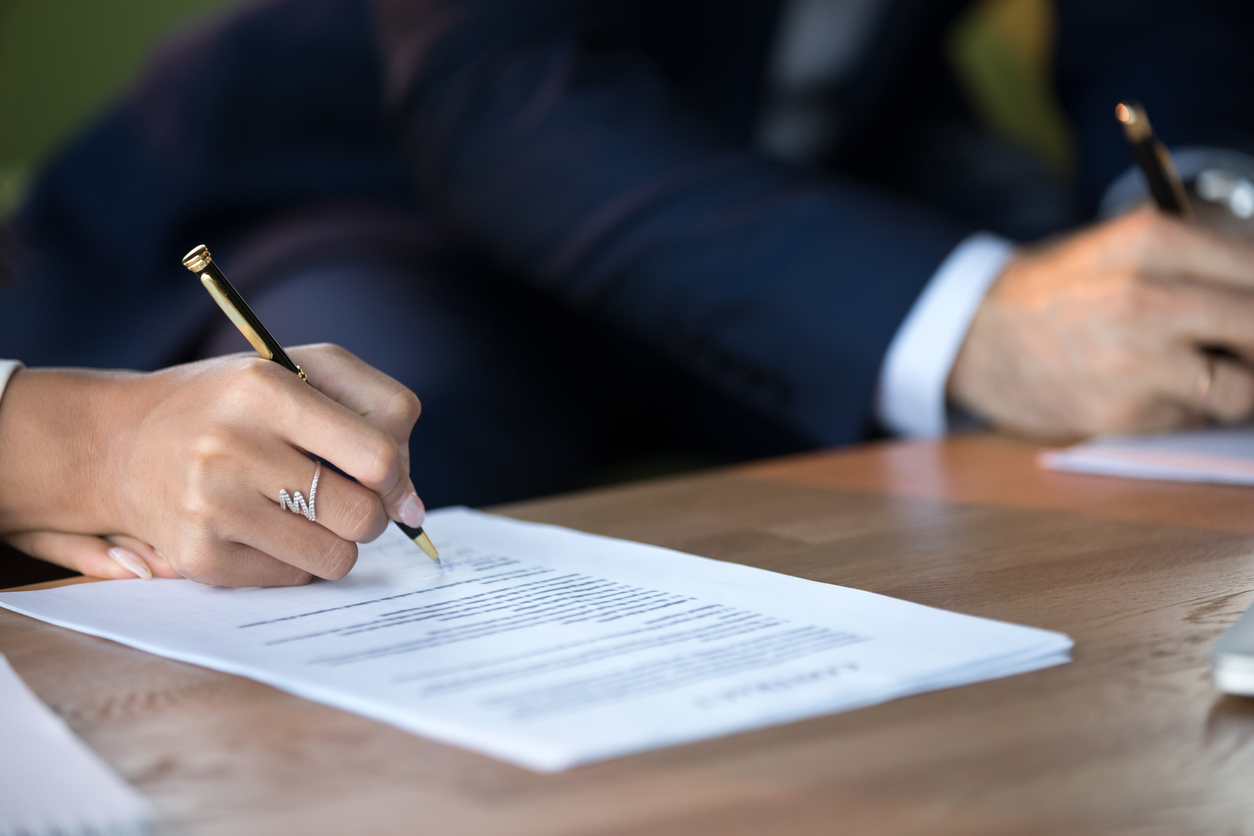 man and wife signing contracts