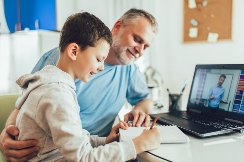 Father and son distance learning