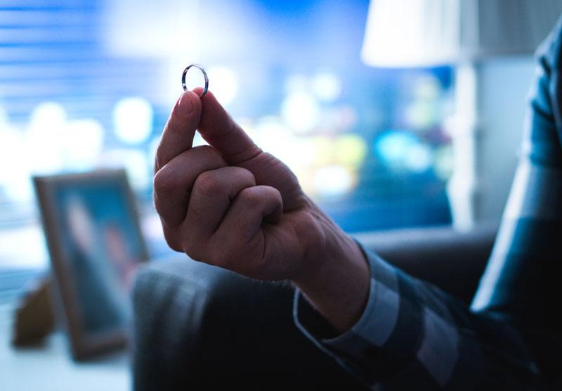 Man-holding-wedding-ring